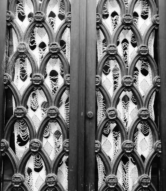 Most of the metal doors had wrought iron decoration. A few, like this, had curtains.