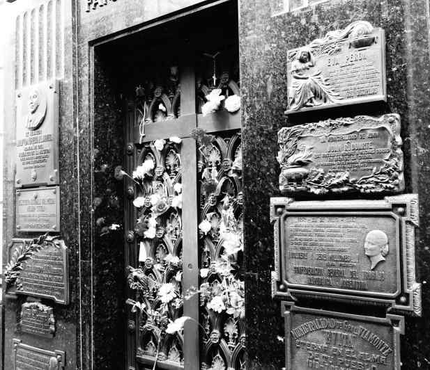 Certainly the most famous person buried in Recoleta Cemetery is Eva Peron, the second wife of the President of Argentina from 1946-1952. People were gathered in front of the Duarte Family vault when we got there, and many fresh flowers were placed in the door's grillwork. Evita has not been forgotten.