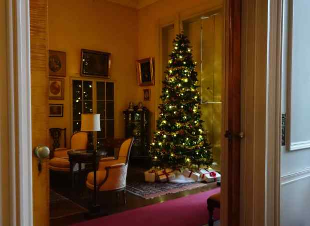 The challenges for photography increased as we strolled through the rooms. The house was dimly lit and relied on daylight coming through the windows, but on this rainy day, it was as dark inside as it was outside. A few Christmas lights were most welcome! (Photo by Beth)