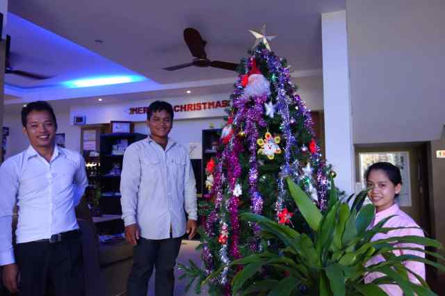 "Will we ever forget the tree lovingly decorated by the hotel staff at 1-Up Banana Hotel in Phnom Penh, Cambodia to make sure their guests feel ""at home"" for the holidays? It was the best tree ever."
