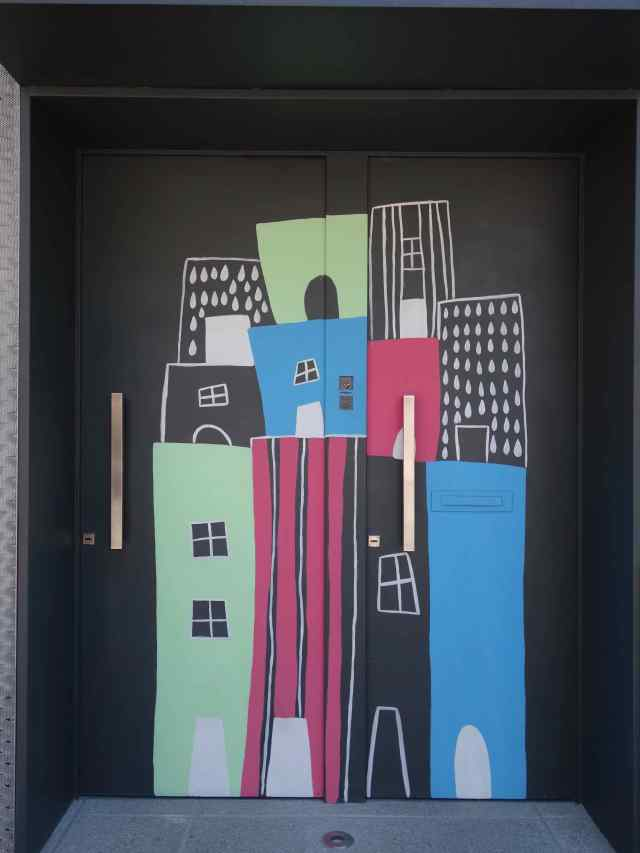 On that same walk, we saw this striking mural on the side of a building. As we studied the artwork, 2 doors appeared within the painting.