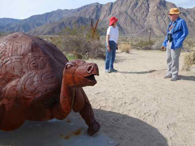 "Marlee and Joe seem oblivious to the giant tortoise ""roaming"" in the desert nearby."