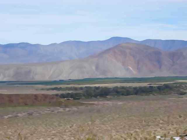 The sharpest color contrast was looking east at the bands of greenery and beige sands right before the mountains.