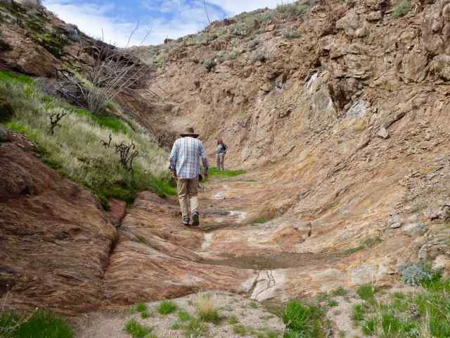 Liz and Steve stayed on the trail, a scoop-shaped rock surface.